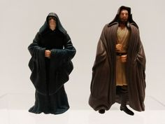 2 Star Wars Figurines - Palpatine with moving Arms & Gui-gon Jinn with Cape 1998  ..... Visit all of our online locations ..... (www.stores.eBay.com/variety-on-a-budget) ..... (www.amazon.com/shops/Variety-on-a-Budget) ..... (www.etsy.com/shop/VarietyonaBudget) ..... (www.bonanza.com/booths/VarietyonaBudget ) .....(www.facebook.com/VarietyonaBudgetOnlineShopping)