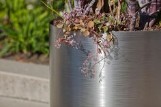 Universal Planter shown with body in Stainless Steel with Satin finish and Seagrass Eco-Etch pattern