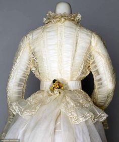 LADY'S WEDDING ENSEMBLE, DEC. 30, 1868 2-piece dress, veil's wax flowers, linen hankie & white silk slippers w/ rosettes: white organdy w/ Valenciennes lace on fitted jacket & trained skirt, all worn by Louise Loomis Burrell of Little Falls, N.Y., very good-excellent; t/w 1 organdy over skirt, 1 pink ribbon trimmed blouse & 1 lace & organdy purse, fair-very good.
