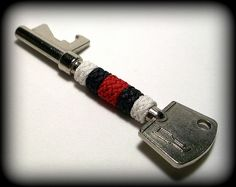 Red, white, & black Gaucho knot covered bottle opener key