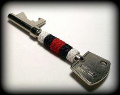 Red, white, & black Gaucho knot covered bottle opener key