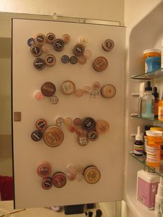 Use your cabinet door with magnets to hang on some more stuff.