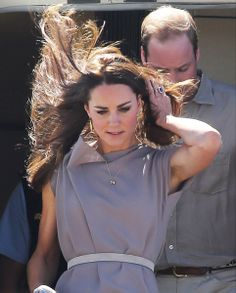 Strong gusts..The wind played havoc with the Duchess' hair as she descended the steps of the jet in Ayers Rock, Australia