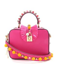 Dolce & Gabbana - Dolce Soft leather shoulder bag - The Dolce Soft shoulder bag from Dolce & Gabbana is crafted from vibrant pink calf leather. The boxy shape comes with multiple carry options – dainty top handle or handy adjustable shoulder strap. Adorned with complementing gold-tone hardware and a voluminous paper trim, this structured beauty is sure to give your looks a ladylike finish. seen @ www.mytheresa.com