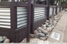 Modern Wood & Metal Retaining Wall--I like the look, but worry about the durability of wood for a retaining wall...