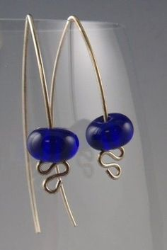 Transluscent Blue Glass and Sterling Silver by DenaultStudios $24.00  love the bottom head pin design