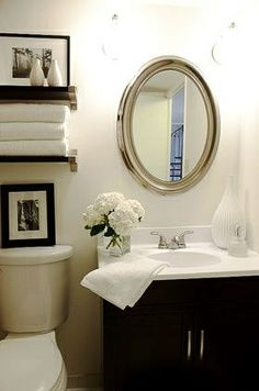 Half bath. Shelves above toilet and how they are decorated. Doesn't have to be black & white, can use warmer colors.