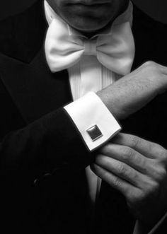 White tie, the most formal of evening wear.  Long coat with tails required. only after 6pm