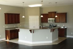 """wood flooring in the dining room  """"tile in the kitchen"""" open floor plan   Classic Home 1674 Options"""