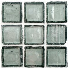 """Recycled Glass Tile Clear Grey 1x1 mounted on a 13""""x13"""" sheet for Kitchen backsplash, bathroom, shower, spa, pool waterline, swimming pool, jacuzzi, floor, and wall. This product is sold by the sheet.This mosaic tile is comprised of between 30 and 70 percent glass from bottles and/or other waste glass that would otherwise have entered the solid waste stream. This waste glass is a mix of approximately 90 percent post-consumer and approximately 10 percent pre-consumer."""