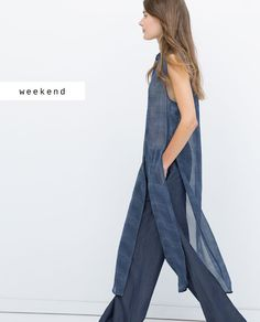 The side slits reveal the pants that cover the belly that should not be seen.