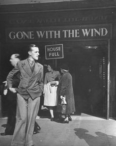 """People outside of the packed Ritz movie theater in Leicester Square which has been showing """"Gone With the Wind"""", London. 1941. S)"""