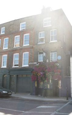 The bunch of grapes. The public house here is The Bunch of  Grapes at the Limehouse end of Narrow Street.  Although, as far as I know it's never been owned by the head of a criminal gang I used the image of it when I described Ma Tugman's pub the Boatman, which I tucked away in Coleman Street.