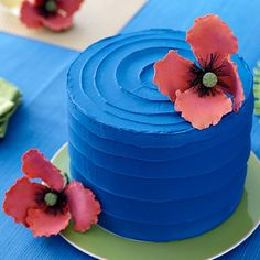 Take a trip to the tropics with a deep blue cake accented with sun-seeking pink poppies. Create the sensational flowers with the Poppy Gum Paste Cut-Outs Set, which includes step-by-step instructions for cutting and shaping petals with a natural look.