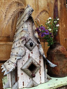 """A Rick Katschke Birdhouse, """"Miss Havisham"""" from century old salvaged woodwork w/ a sculpted tin roof and a Victorian cabochon adornment"""