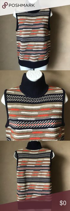 Diane von Fursternberg 'Carsyn' Turtleneck NWT Diane von Fursternberg Carsyn Sleeveless Turtleneck Sweater Vest Blue NEW!  This multicolored 'Carsyn' vest from Diane von Furstenberg is effortlessly chic, the snug silhouette and turtleneck is easy to slip on for business or brunch. Orange/navy/white/beige blend with merino wool and silk, turtleneck. Slim, fitted silhouette.   41% Merino Wool, 34% Cotton, 11% Silk, 7% Acrylic, 6% Viscose, 1% Polyester. Color: blue / multi-color D198597F Diane…