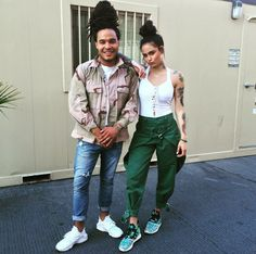 Kehlani posted up in eye-catching green pants and a pretty pair of Adidas Tubular print sneaks.