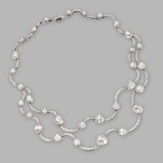 KESHI PEARL AND DIAMOND 'DOUBLE WAVE' NECKLACE, TIFFANY & CO.,  FRANCE. Keshi pearls measuring approximately 12.0 to 5.0 mm., round diamonds weighing a total of approximately 8.80 carats, mounted in platinum, length 16 inches, signed Tiffany & Co., © 2001, France.