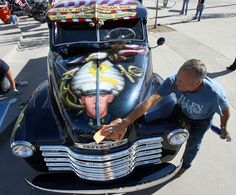 Dave Vinnedge, father of Lance Cpl. Phillip David Vinnedge, who died while serving in Afghanistan, polishes the vintage truck he, and his wife, Julie, restored in honor of their son. It was on display during a Sept. 11 memorial event in West Valley City. (Steve Griffin   The Salt Lake Tribune)