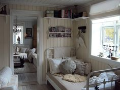 Norwegian design- want shelves up high like that and a beautiful candelabra in the window:)