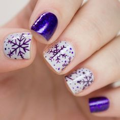 Blue violet and white themed snowflakes nail art. Add variety to your snowflakes nails by adding polka dots around the snowflakes and creating a sandwich illusion using the sheer blue violet polish.
