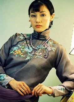 Michelle Reis, in the dress of Traditional Chinese silk dress.