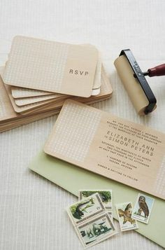 Balsa wood invites...does require a custom stamp, but they are cool. Handmade-weddings book.