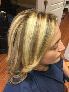 Heavy highlights and a few noticeable lowlights for this blonde beauty! Long hair styled in curls and then broken up to be beachy