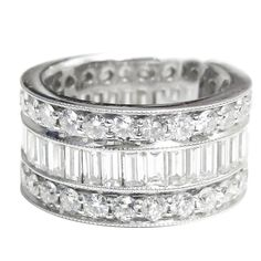 Stunning Eternity Wedding Band features 6.00 carats of round and emerald cut diamonds.