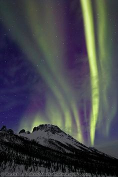 ~~How to Photograph the Northern Lights eBook | Aurora borealis swirls across the sky over the Brooks mountain range, Snowden mountain, arctic Alaska by Patrick J Endres~~