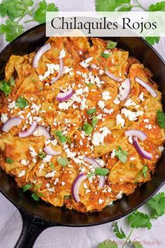 A perfect breakfast or brunch recipe, Chilaquiles Rojos is a comforting plate of fried tortillas simmered in red salsa and topped with cheese. Add an egg and beans and you have yourself one satisfying breakfast! Mexican Appetizers, Mexican Breakfast Recipes, Mexican Dishes, Mexican Brunch, Mexican Food Recipes, Mexican Eggs, Breakfast Appetizers, Brunch Food, Chilaquiles Rojos Recipe