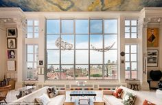 Fairytale lifestyle: Incredible views over Central Park are highlighted by gigantic floor-to-ceiling windows and elegant cream-coloured walls and furnishings