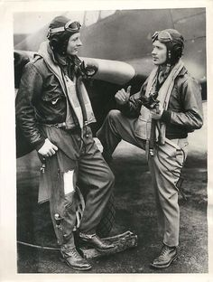 Lt. Warren S. Emerson of Neligh, Nebraska (right) downed two ME-110s over Kiel during a recent raid and although he was wounded, flew his damaged plane back to his British base. The Mustang pilot tells his story to his group commander, Col. Kenneth R. Martin (left) of Kansas City, MO, who holds the DFC. Feb. 2, 1044.