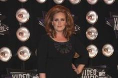 Adele's baby son could well be called Angelo as the award-winning singer was photographed in Los Angeles wearing a necklace with the name on it
