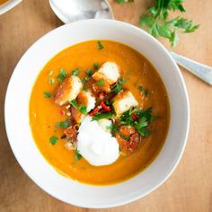 Maple-roast pumpkin and onion soup with haloumi, mint and chilli