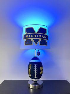 University of Michigan Football Lamp, NCAA, man cave, sports, Michigan Football Light, Blue and Yellow lamp, Michigan. Football, Football Light, Football lamps, handmade, home decor, kids room decor, boys room decor, college football, lamps, unique gifts, by CaliradoArt on Etsy www.etsy.com/...