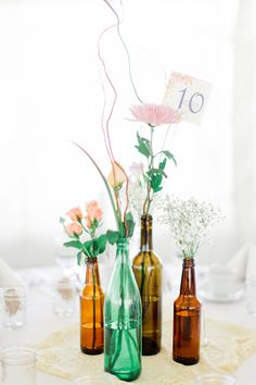 Collect glass bottles for an eclectic table set up. See more eclectic wedding ideas here http://www.weddingchicks.com/2013/08/28/vintage-backyard-wedding-2/
