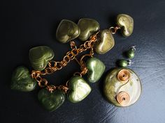 rich deep green and gold UTEE hearts set with swirl pendant