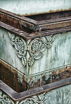 Verdigris: the common name for a green pigment obtained through the application of acetic acid to copper plates or the natural patina formed when copper, brass, or bronze is weathered and exposed to air or seawater over a period of time.