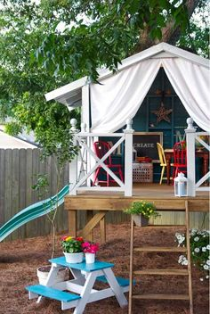 backyard playhouse with slide exit.