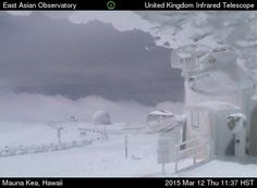 March 12. 2015: Just before noon on Thursday, the blizzard allowed summit webcams to glimpse the observatories partially buried in snow.