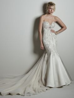 Sottero and Midgley - DARREN, Bead embroidered lace motifs featuring Swarovski crystals waltz over this dramatic Carlo satin wedding dress, sweetheart neckline, and illusion plunging back with exposed boning. Fit-and-flare skirt features a tulle train. Finished with crystal buttons over zipper closure. Available in plus size.