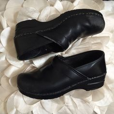 Dansko Black Leather Clogs Worn down, super comfy, and well broken in Dansko Black Leather Clogs. Lots of scuffing & wear as shown in pictures. Size Euro 40, fits like a 9 with socks 9 1/2 without. As Forrest Gump says 'Momma always says there's an awful lot you could tell about a person by their shoes. Where they're going. Where they've been'. Maybe You could give these shoes a second life :) Dansko Shoes Mules & Clogs