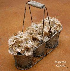 - Bucket - jute or burlap - upholstery tacks - floral foam or styrofoam - brown paper