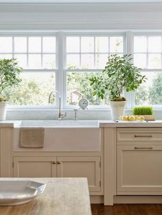 Cottage Crush, white kitchen, farm house sink, windows over kitchen sink, no uppers, marble countertop - Love the color of the cabinets