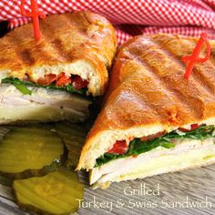 Grilled Turkey & Swiss Sandwich - spinach, sliced tomatoes & sauteed onion slices.  Allrecipes.com