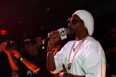 Snoop Dogg aka Snoop Lion raps all his hits on a very blinged out mic.