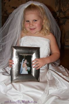 I took the idea another step and had her hold a picture of me in my wedding dress on my wedding day.  Maybe she can do the same when she has a little girl :)