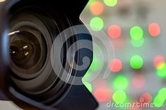 Professional Camera Lens with bokeh Christmas lights background