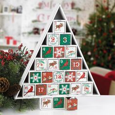 3f15250317f Count down the days to Christmas with this rustic wooden Advent calendar.